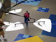 Calder with travelers (evinglenside) Tags: sculpture mobile modern airport pittsburgh pa kinetic calder publicart