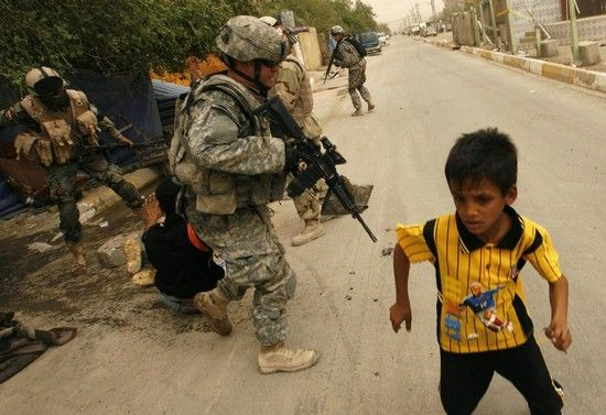 20080713_boy_running from_his_home_as_American_soldiers_drag_his_father_outside
