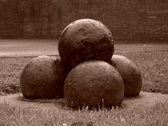 Four Brown Balls () Tags: abstract metal sepia ball four military balls testicles basic ammunition sepiatone cannonballs munitions mimimal mimalist ironshot