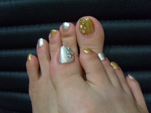Glamour set of gold and silver colors on nail art design  for toe nails., toe nail art