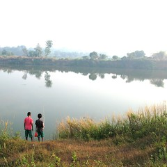 Friendship ([Jongky]) Tags: boy red sky lake holiday fish boys water grass children indonesia fishing friend friendship air ali human childrens awan sahabat danau redtshirt tangerang refflection persahabatan liburan mancing banten bayangan legok galianpasir