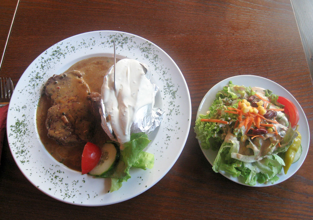Argentenian Rump Steak on Pepper Sauce with Baked Potato, Sour Cream and Salad - Maximo in Heidelberg