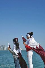 الاطفال يحتفلون وهم يحملون الاعلام القطرية (Maryam.Ibrahim) Tags: sea baby girl december day national corniche 18 doha qatar