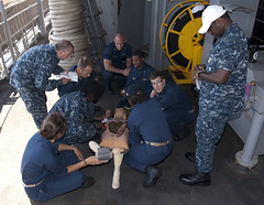 Sailors simulate administering first aid to a training mannequin during a damage control Olympics aboard USS Whidbey Island (Official U.S. Navy Imagery) Tags: mannequin training navy sailor olympics dummy usnavy mediterraneansea firstaid damagecontrol amphibiousdocklandingship usswhidbeyislandlsd41