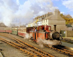 "Late afternoon train on the Ffestiniog Railway, departing from Porthmadog, Wales, April 7, 2004, led by Fairlie's Patent locomotive ""David Lloyd George"" (Ivan S. Abrams) Tags: arizona wales nikon ivan nikond100 eisenbahn trains getty nikkor abrams railways trainspotting locomotives gettyimages railroads smrgsbord ffestiniograilway porthmadog northwales tucsonarizona steamlocomotives oldtrains davidlloydgeorge narrowgaugerailways narrowguagerailroads nikondslr oldlocomotives railfans 12608 touristrailways transpotting ukrailways removedfromnikkorfortags anawesomeshot impressedbeauty railwayenthusiasts europeanrailways diamondclassphotographer flickrdiamond touristrailroads onlythebestare 2footgaugerailways ivansabrams trainplanepro pimacountyarizona safyan arizonabar excursiontrains arizonaphotographers ivanabrams welshnarrowgaugerailways sportsmanhotelporthmadogwales cochisecountyarizona europeanrailroads ffestiniiograilway 2485mmnikkorlens slaterailways sportsmanhotelporthmadog excursionrailways excursionrailroads 2footgaugerailroads fairliespatentlocomotive articulatedsteamlocomotive gettyimagesandtheflickrcollection copyrightivansabramsallrightsreservedunauthorizeduseofthisimageisprohibited tucson3985gmailcom ivansafyanabrams arizonalawyers statebarofarizona californialawyers copyrightivansafyanabrams2009allrightsreservedunauthorizeduseprohibitedbylawpropertyofivansafyanabrams unauthorizeduseconstitutestheft thisphotographwasmadebyivansafyanabramswhoretainsallrightstheretoc2009ivansafyanabrams abramsandmcdanielinternationallawandeconomicdiplomacy ivansabramsarizonaattorney"