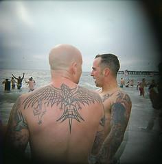 Tattooed men, Coney Island, Brooklyn, 2008. (Valery Rizzo) Tags: ocean camera new york urban men art film beach tattoo brooklyn square coneyisland photography holga cool contemporary fine tattoos plastic series medium format hip woca journalism
