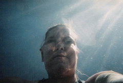 35/700-21A Self-Portrait (Melissa Maples) Tags: blue sea woman selfportrait film beach me water swimming lomo lca lomography europe mediterranean kodak lka aegean melissa greece maples  waterproof disposable samos   pythagorio           kourosbay