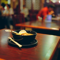 A Ramen Lunch (Inside_man) Tags: people newyork 120 6x6 mamiya tlr c220 film mediumformat miso colorful bokeh manhattan tasty ramen chopsticks broth woodtable noodlesoup portranc bigspoon blackbowl slicedpork aramenlunch