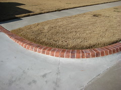"After ""Brick"" Driveway Edge (Impressive Restorations) Tags: oklahoma oklahomacity concreteart concretedesign impressiverestorations concreteresurfacing permacrete danielware jorgeware stephanieware paulaamold wwwimpressiverestorationscom 4058245910"