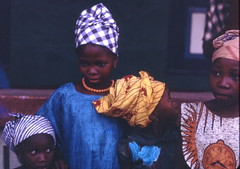 Mandingo girls dressed up for a celebration, Kabala, Sierra Leone (west Africa) 1968 (gbaku) Tags: pictures africa girls west history girl fashion children town photo 60s village child photos native african femme headscarf picture villages sierra historic photographs sierraleone photograph westafrica tropical afrika historical 1960s anthropologie northern towns leone fille mande sixties province anthropology filles femmes africain fashions afrique ethnography ethnology africaine mandinka kabala wara mandingo westafrican headcloth warawara ethnologie afrikas goldstaraward
