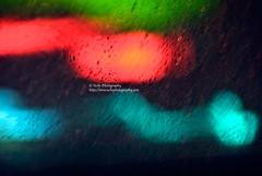 green red aqua behind rain (simis) Tags: red green window rain drops aqua bokeh photowalk pane fromarchives