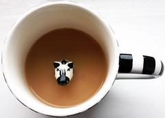 Animal Cruelty (oh-so-rosie) Tags: white hot cup photoshop canon tea zebra mug cupoftea cuppa animalcruelty hotdrink englishtea breakfasttea