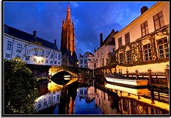 A Night Out With Our Lady (Nathan Bergeron Photography) Tags: sunset tower church architecture reflections geotagged boats lights canal interestingness europe view belgium brugge medieval unesco worldheritagesite bruges bluehour oldworld churchofourlady westflanders explored flemishregion yearinfrance riverdijver geo:lat=51205925 geo:lon=3225549