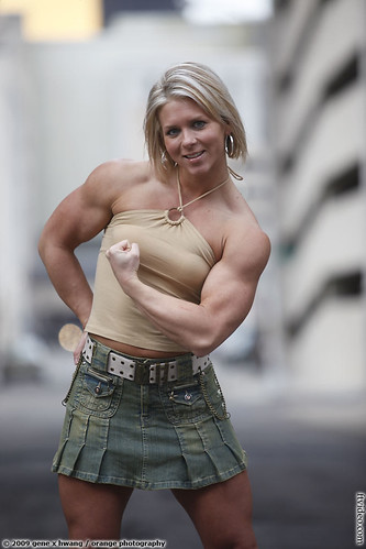 Kristen Curlee Flexes Biceps