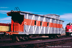 Old western Pacific wooden steam era caboose in modern 1950's era silver and orange paint. From the internet.