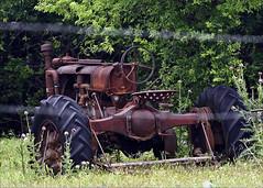 Rusty Oklahoma Tractor (hz536n/George Thomas) Tags: summer tractor oklahoma rust perkins 2008 cs3 canon30d canonef70200mmf4lusm