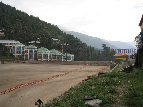 The view across the activity field toward distant mountains