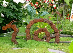 22/365: a dragon lurks in the Eastlake P-Patch (missjenn) Tags: art bike bicycle metal garden rust dragon gardening snail chain project365 eastlakeppatch
