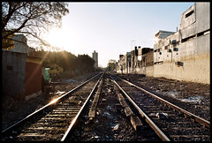 Your own guey. (Bitten Apple Inc.) Tags: 2 building train tren rail via roads distance sunray railroads lanes vias simetrical elitephotography