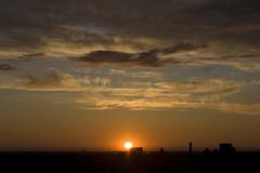 June Rooftop Sunset (ilovemycanon) Tags: sunset sky sun clouds winnipeg 28135mmis canonxti
