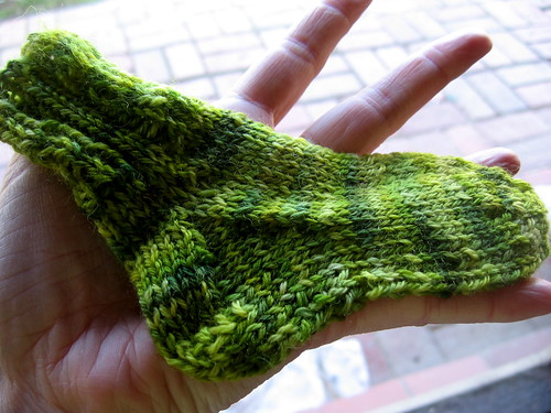 green baby sock for Nina