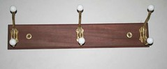 Brass & Porcelain Coat Hooks on African Mahogany (Imagination Unincorporated) Tags: african brass mahogany coatrack wallmount porclain