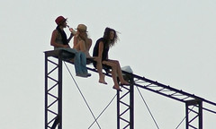 Three girls on top of the Rosslyn neon sign