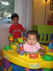 Aki is in the Exersaucer