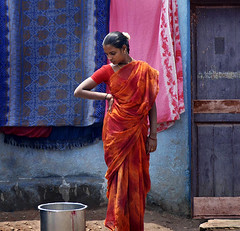 A Watched Pot... (Rick Elkins) Tags: door pink blue red orange woman india colors wall standing looking candid bangalore streetphotography pot karnataka staring gazing sari themoulinrouge passionphotography mywinners platinumphoto anawesomeshot aplusphoto goldenphotographer artofthelight multimegashot thetempleofaphrodite rickelkins