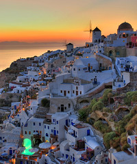 A beautiful summer story... (MarcelGermain) Tags: travel houses light sunset sea summer vacation sky orange sun water windmill buildings geotagged outdoors greek volcano town nikon holidays mediterranean aegean windmills santorini greece grecia caldera ia ea grce oia cyclades cycladic grcia d80 marcelgermain