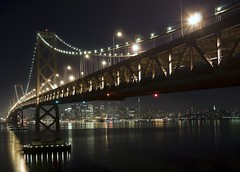 A Night Under The Bay Bridge (Matt Granz Photography) Tags: ocean sf sanfrancisco california longexposure bridge black water skyline architecture night danger buildings reflections island photography lights bay coast flickr waterfront treasureisland view skyscrapers nightshot streetlights steel postcard scenic bridges landmark icon tourist hike structure hills explore coittower baybridge bayarea transamerica yerbabuena 510 rare portofsanfrancisco 415 interstate80 waterreflections yerbabuenaisland citiscape sanfranciscoskyline pyramidbuilding businessdistrict top20longexposure infinestyle