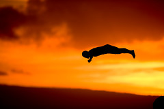 Cliff Diver (Russ Beinder) Tags: sunset topf25 silhouette hawaii topc50 ceremony maui getty hi diver kaanapali sheratonhotel cliffdiver anawesomeshot