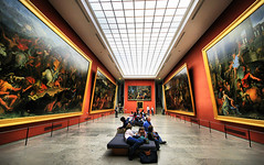Lounging at the Louvre (` Toshio ') Tags: travel people woman man paris france building men art girl museum architecture french women europe paint european artistic louvre interior paintings culture wideangle palace tourists ceiling oilpaintings europeanunion museedulouvre toshio kingphilippeauguste