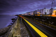 Next stop: Seapoint, Dublin, Ireland (jogorman) Tags: ocean sea dublin water clouds train dark twilight nikon long exposure waves crash dusk tide transport sigma stormy system explore transit area lighttrails nikkor seafront ie 1020mm 1020 swell rapid dart regional explored d3x