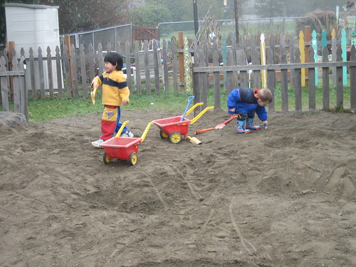 Aidan and Christian working hard in the sandbox at preschool