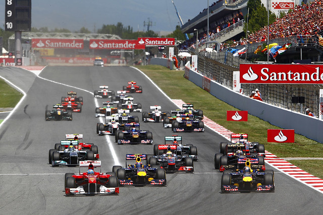 Fernando Alonso, Ferrari 150° Italia takes the lead at the start of the Spanish grand prix