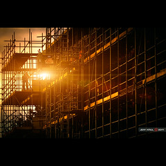 Construction site (Jeff Krol) Tags: street city sunset sun cinema building work canon square eos construction scaffolding lift steel elevator pipes streetphotography flare worker f2 cinematic hoogeveen builder 135mm scaffolder f20 canonef135mmf2lusm 60d canon60d jeffkrol