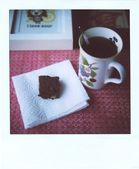 B is for brownies (*Juliabe) Tags: winter light film home cup polaroid sx70 baking afternoon tea weekend lazy instant teacup brownies myeverydaylife savepolaroid framingsomegoccoartworkipurchased