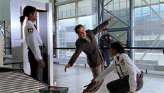 Adrian Monk goes through a body check at the airport