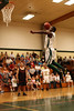 Packers Wide Receiver James Jones mid-air to the basket