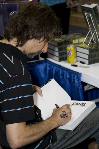 Mike Wolfer signs a Gravel hardcover