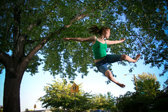 JUMP this is what I do when I take my cat outside on warm summer nights (laurenlemon) Tags: blue sunset summer sky tree green fun outside jump jumping play young barefoot shorts ponytail jumpology sunpak544 laurenrandolph laurenlemon