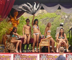 Edinburgh Fringe: Ladyboys of Bangkok (chairmanblueslovakia) Tags: two festival asian scotland fan high chair edinburgh boots body bangkok bald posing fringe bikini pouch thai heels cabaret piece float picnik transsexual ladyboys shemale boyish lithe thaland kathoey of