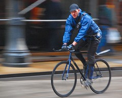 Blue courier (jeremyhughes) Tags: winter chicago motion blur cold bicycle speed movement nikon explore gloves singlespeed fixie fixedgear messenger nikkor courier panning bikemessenger d40 jeremyhughes fixedwheel bikecourier cyclemessenger cyclecourier nikond40