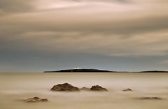 Inner Farne Island Lighthouse from Seahouses (Corica) Tags: uk longexposure greatbritain england seascape beach landscape rocks britain northumberland bamburgh farneislands basalt seahouses dolerite corica greatwhinsill