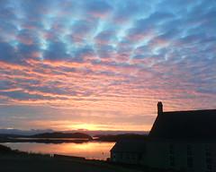 Crossbost sunrise - January 2009 (cmcrossbost) Tags: sea sky reflection tree clouds sunrise scotland hills westernisles isleoflewis hebrides lochcrossbost crossbostfreechurch