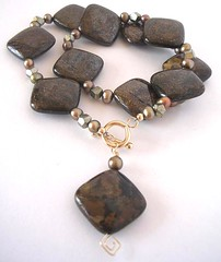 bronzeite in a necklace with pearls and hematite crystals
