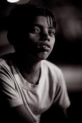 Boy on River Ganga (Josiah!) Tags: india slr digital photoshop canon lens eos reflex mark iii telephoto adobe single varanasi 12 dslr 1ds josiah lightroom f12 benares mark3 canonef85mmf12lii canoneos1dsmarkiii 1dsmarkiii canon1dsmarkiii 1dsmark3 josiahpugh eternallyaddicted pughphotography