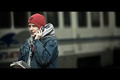 Angel Researcher (Dom Cruz) Tags: street portrait people usa newyork man guy canon book spring buffalo downtown dof unitedstates bokeh candid streetphotography cellphone tram denim conversation cds cinematic f20 135l canonef135mmf2lusm 40d canoneos40d