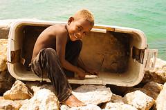 Preparing the bait (-Passenger-) Tags: sea beach kid fishing dock colombia blondie atlanticocean bait bigsmile caribbeansea cruzadas santacruzdelislote